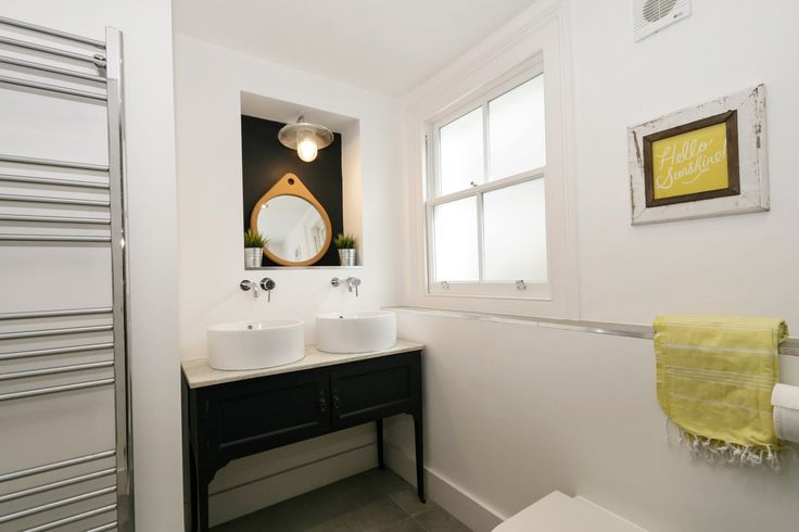 Bathroom first floor. Victorian washstand painted and added two washbasins to it.