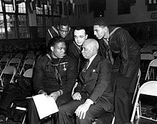 Doris Miller - Miller speaking with sailors and a civilian at Naval Station Great Lakes, January 7, 1943.