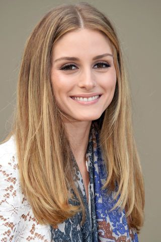 Be confident in a long, straight middle part. Olivia Palermo shows off this classic look.