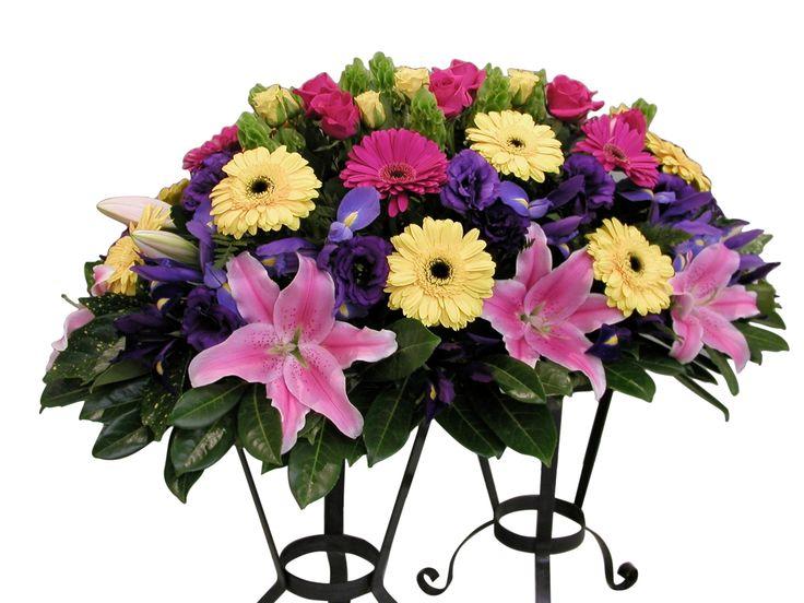 Casket including oriental lilies, gerberas, roses and iris - Donvale Flower Gallery