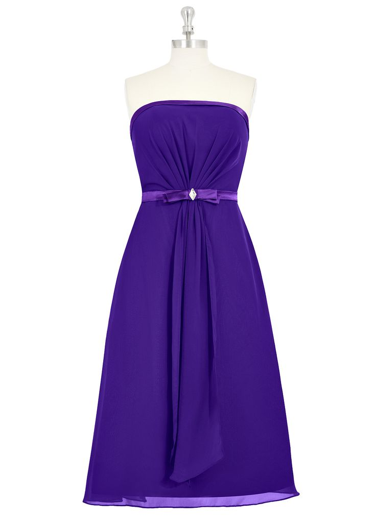 The Azazie Kaylie is a dainty bridesmaid dress that's perfect for a classic wedding. The strapless dress features silk lining on the bodice and waist, am embellished bow belt, and ruched detailing down to its tea-length. Available in 34 colors, seen here in Regency.