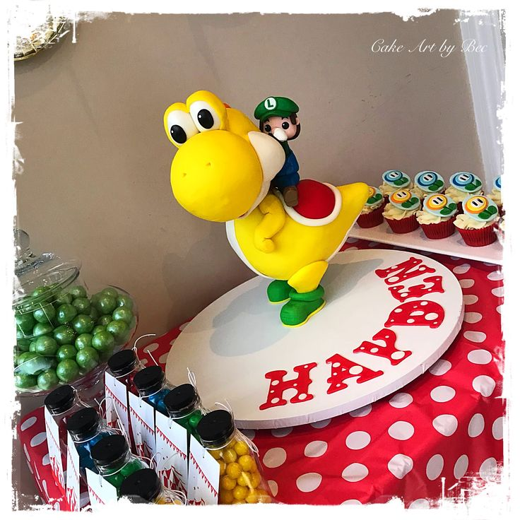 Hayden requested a Yellow Yoshi with Luigi riding him as his cake.  The cake is chocolate mud cake with dark chocolate ganache covered in fondant. The armature inside is made from wooden dowels and foam core.