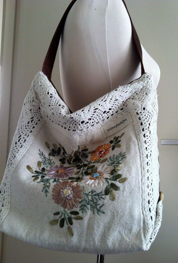 This adorable floral shoulder bag is made of vintage hand embroidered ecru linen with a crochet border. Just the bag for boho lovers!  Bag closes