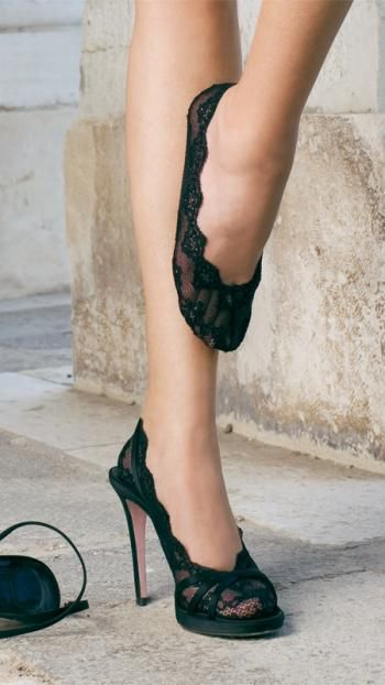 These black lace foot covers are perfect for wearing under heels. Cute