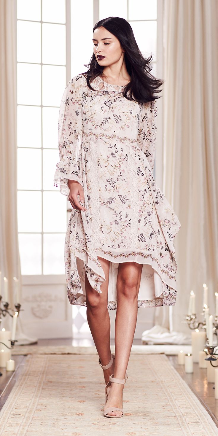 The billowy sleeves and high-low hem perfectly complement the sweet floral print of this romantic dress. Blush tone heels complete the look. Shop the complete LC Lauren Conrad Runway Collection at Kohl's.