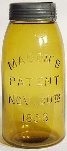 A bright yellow-amber colored 1858 half gallon with very bold embossing. Improved style mouth finish with a plain amber glass insert and excellent Bett's band. Beautiful condition and extremely heavy and sharp embossing. Antique Fruit Jar Hall of Fame