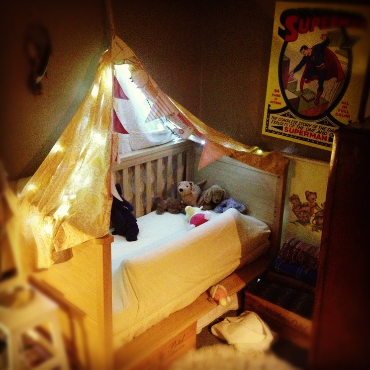 Cot conversion. Now a little home, lights, bunting & one hell of a comfortable sleep.