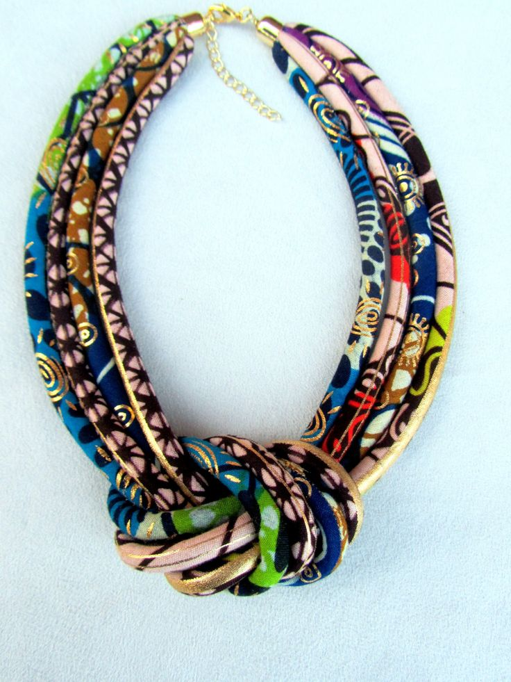 African Fashion fabric bib necklace, african wax golden metalic print with a central knot . - pinned by pin4etsy.com