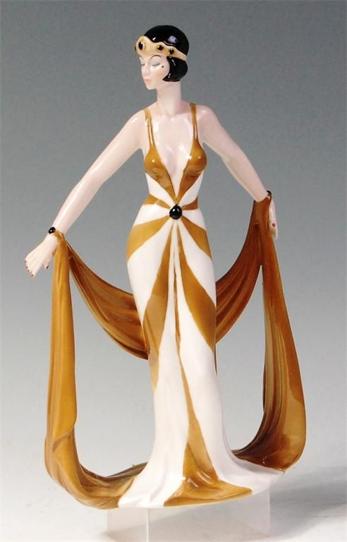 Art Nouveau style glazed porcelain figurine, of a full length standing female with drapery, stamped Rodin, design by Di Kay.