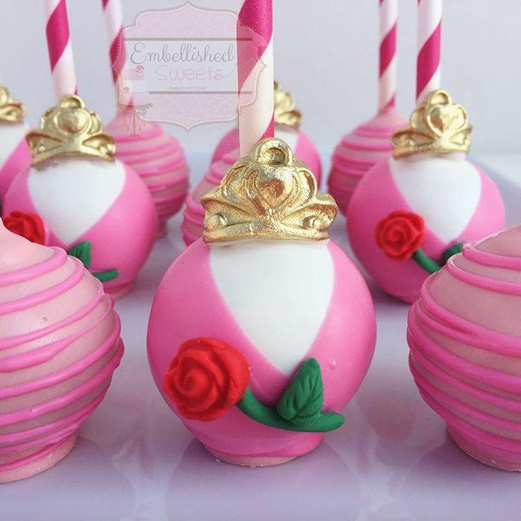 Princess Aurora themed cake pops!! || Inspiration @opopsbyangie || #princess #aurora #cakepops #roses #crown #sleepingbeauty #gold #pink #chocolate #kidsparty #birthday #cute #dessert #embellishedsweets