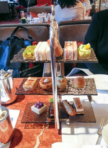 An afternoon tea set at the Mandarin Oriental, Hong Kong's Clipper Lounge. - The Clipper Lounge is like an old, reliable friend. Sure, it's upscale, but relaxed enough to collapse in the comfortable chairs after a morning full of shopping and sightseeing.