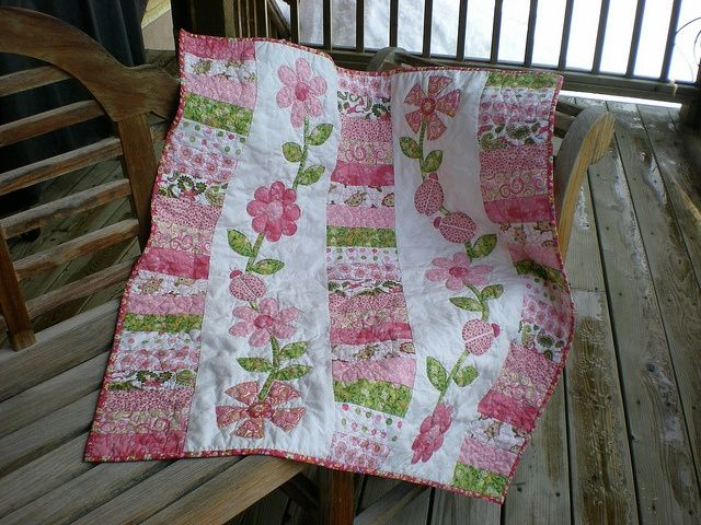 What a great way to use up scraps - strips of patchwork connected by strips of applique.  Beautiful don't you think?