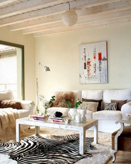 Love how they play with texture within a neutral color palette. Also, that painting!