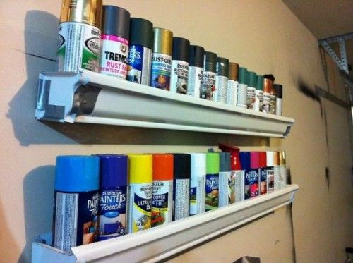 Upcycle your gutters for garage organization! Old gutters can be recycled into a garage storage solution! Install them up high in the garage to hold spray paint and cleaning products to keep out of reach of the kids.