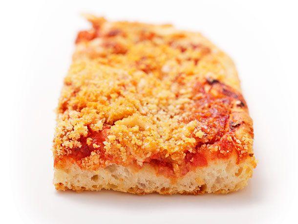 Sfincione (Sicilian New Years Pizza with Bread Crumbs, Onions, and Caciocavallo) from Serious Eats (http://punchfork.com/recipe/Sfincione-Sicilian-New-Years-Pizza-with-Bread-Crumbs-Onions-and-Caciocavallo-Serious-Eats)