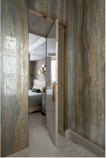 Incredible marble walls in this Paris apartment make a bold yet sophisticated statement. #design #walls #interiors