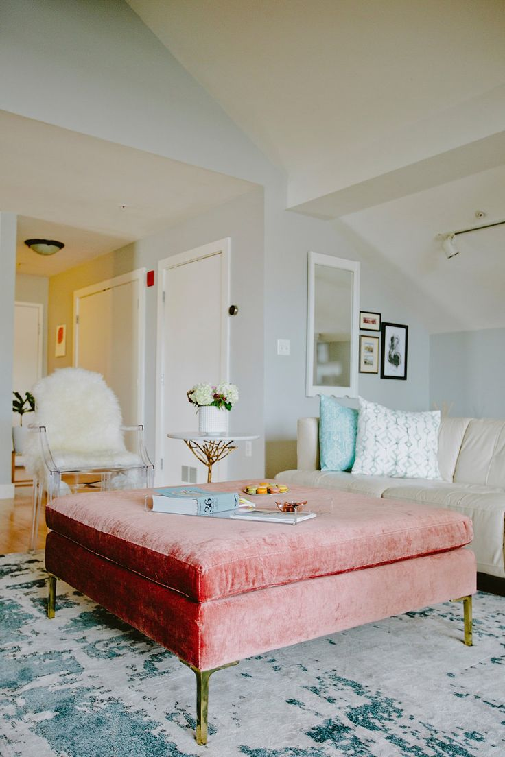 velvet cocktail ottoman adds so much cozy charm to this living room Photography : Amy Emily Read More on SMP: http://www.stylemepretty.com/living/2016/06/22/youll-never-guess-what-this-chic-loft-was-before-it-was-renovated/