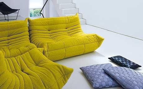 Minimal interior: the study with a 'togo' sofa by michael ducaroy for ligne roset