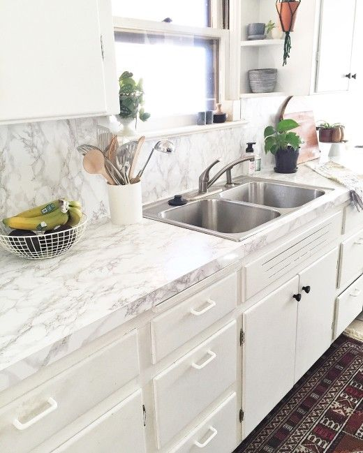 Easy solution to change your counters in a rental or on a teeny budget. via Simply Grove