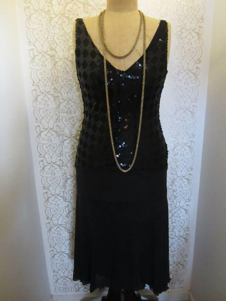 Sequined black evening dress