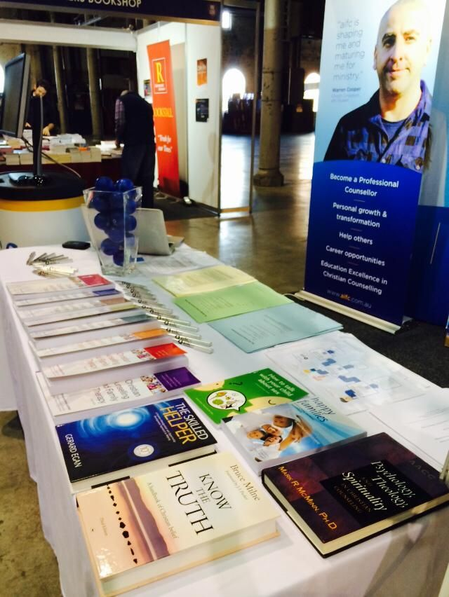 aifc's table setup at the One Love conference 2014