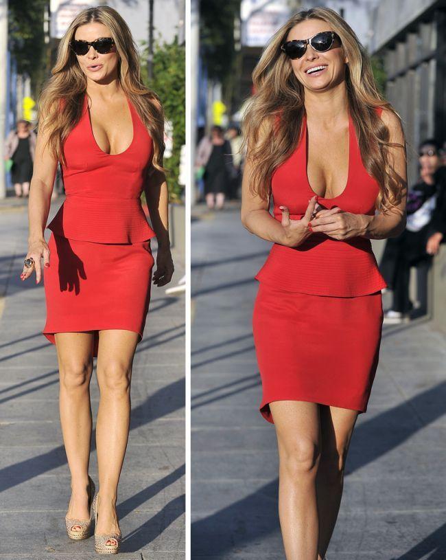 Carmen Electra looks amazing: cat eye tortoise frames, red peplum dress, crystal heels