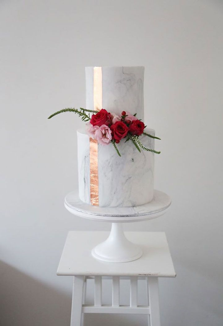 2 tier white & gray marble cake with vertical rose gold stripe.