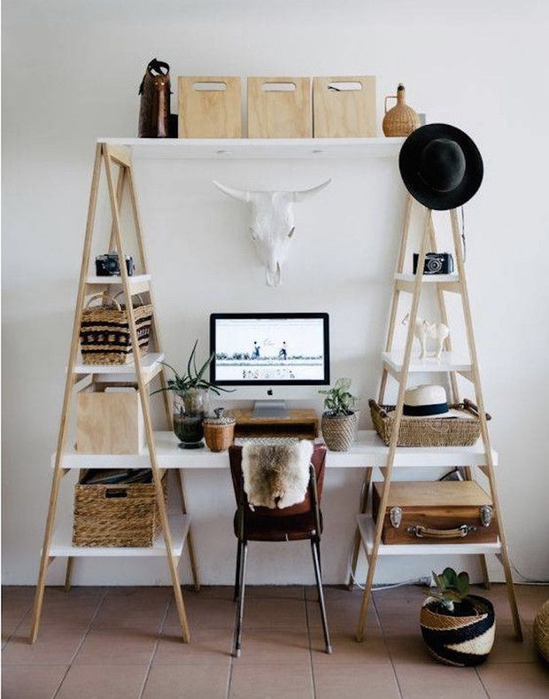 desk framed by two bookcases