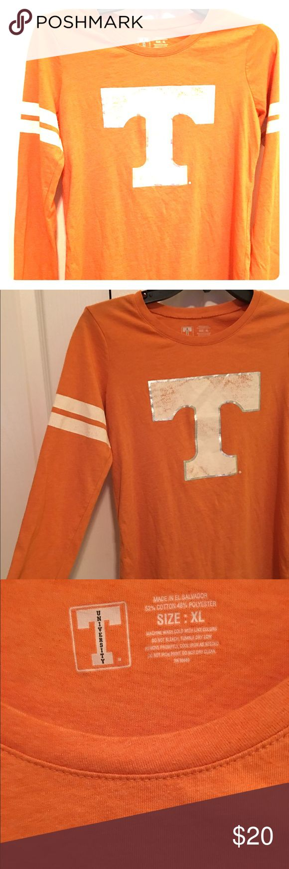 UT University of Tennessee long sleeve orange Official UT long sleeve Tshirt. Cotton blend.  Orange with white T in front and Nice double white stripes on sleeves.  Appears to run a little small. I would recommend for Size L Tops Tees - Long Sleeve