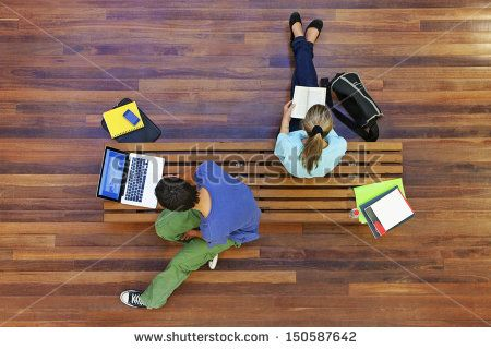 Top view of male and female university students studying - stock photo