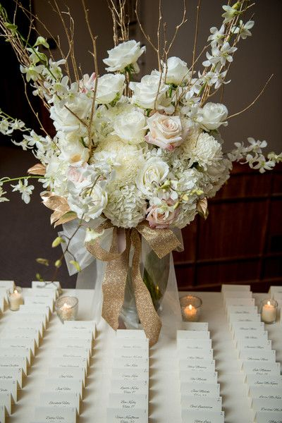 Neutral + gold winter wedding - elegant pastel pink + cream flower arrangement with sparkly gold ribbon {NeriPhoto}