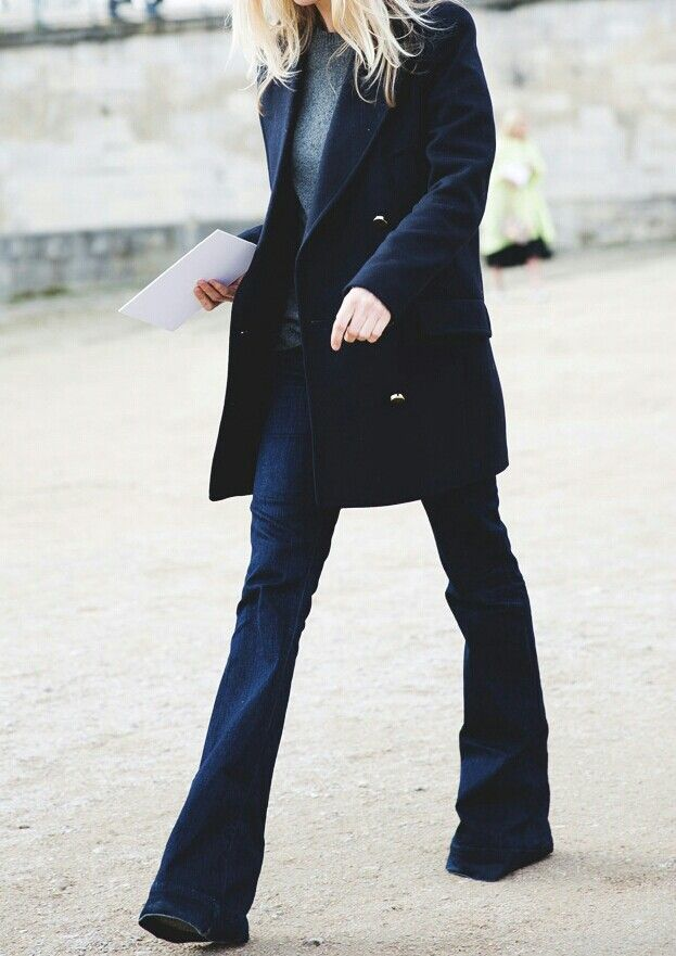 Navy coat with gold buttons and dark denim flares