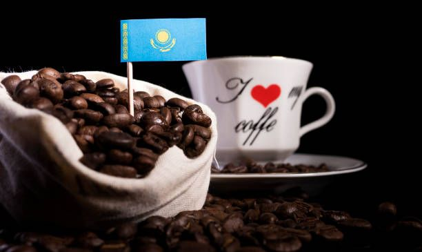 kazakhstan flag in a bag with coffee beans isolated on black