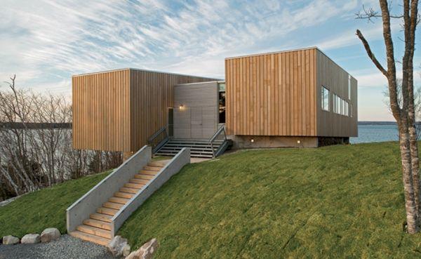 Two Hulls House nestled on the coastal landscape