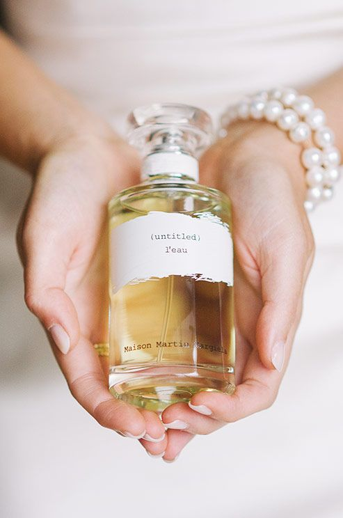 The Bride Holds Her Signature Perfume Worn For Wedding Day
