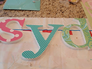 Neat idea for fabric covered letters. Might try foam core for the letters...
