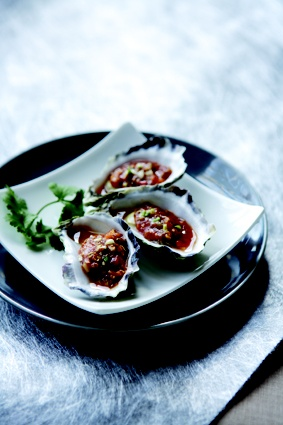 Oysters with signature house spicy garlic sauce....enjoy! @Blue Eye Dragon  Image copy right from New Holland Publishers Australia     #pyrmont #sydney #food