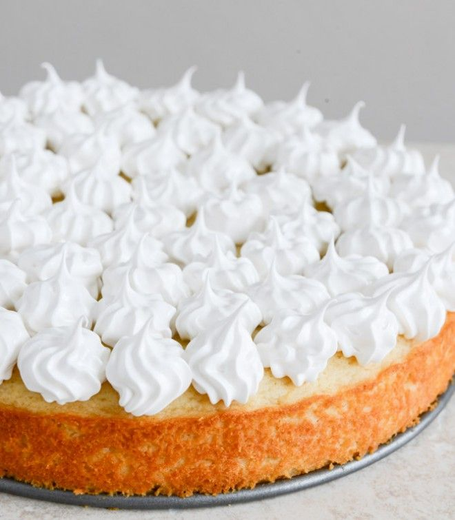Easy Lemon Cake with Marshmallow Frosting + Toasted Coconut I howsweeteats.com