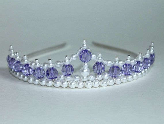 This tiara measures 1.5 inch or 4 cm high at its peak and is adorned with lovely purple beads and pearls. This is the perfect tiara for the