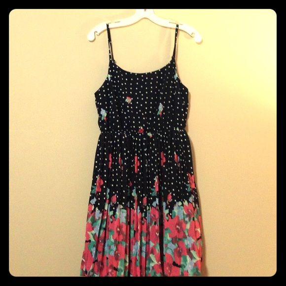 Polka dot floral sun dress Black with white polka dots, elastic waist, pleated skirt. Pink floral pattern grows over bottom half of the skirt. Forever 21 Dresses