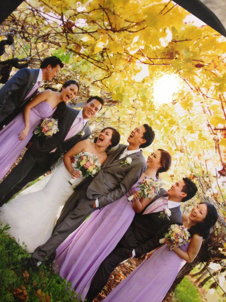 Happy snap of the bridal party in a vineyard - ze photography