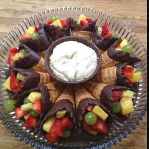 Fruit filled waffle cones. Dip cones in chocolate and fill with cut fruit. Use favorite fruit dip. This one is 1 block creme cheese and 1 jar marshmallow fluff, blend until smooth. Add tsp vanilla if you like.