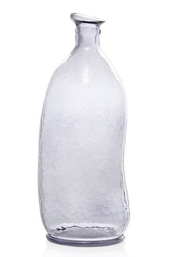 20 Party Decorations For Decor Snobs #refinery29  http://www.refinery29.com/54081#slide-10  In place of a traditional carafe, we love this organic glass bottle for decanting drinks.French Connection Home, Mottled Glass Decanter, £25, available at French Connection.