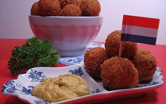 Bitterballen - Bitterballen are deep-fried and crispy breaded rounds with a tender, savory filling. Traditionally made with beef, they can also be prepared with chicken, veal or even with mushrooms, for those that prefer a vegetarian option.