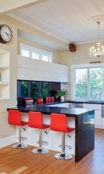 Kitchen featuring Caesarstone Jet Black, designed by Colleen Holder