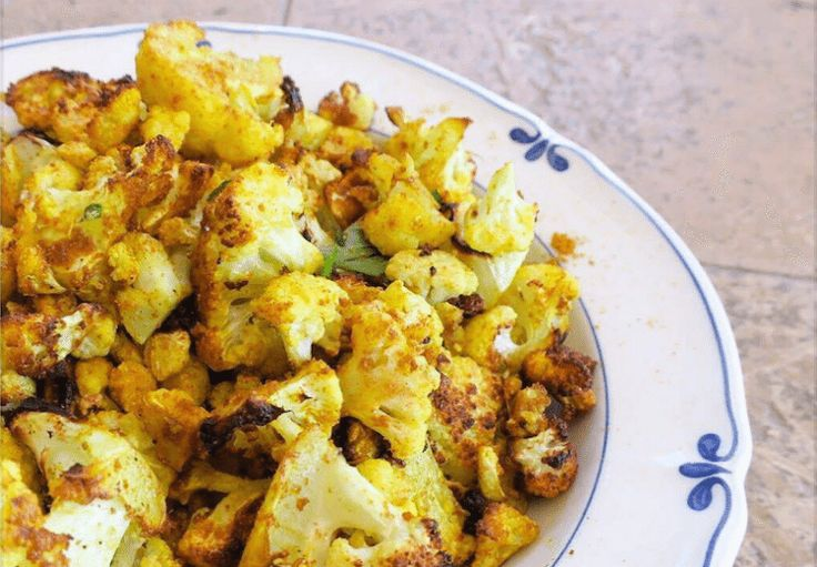 My favourite side-dish at the moment! Make a big batch of this for your next dinner party, or alternatively you can toss it through a salad to add texture and flavour.  Curried Cauliflower Se…