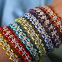 hemp bracelet - a bead is added to both sides of the square knot each time it's tied.