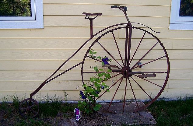 gardening, gardening, repurposing upcycling, We have a friend who owned a junkyard He s also an artist and he built this vintage bicycle for us out of scrap parts and pieces Our Clematis is beginning to climb the wheel