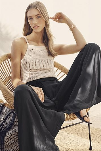Crochet Look Cami  and black pant. The flowy silk-like fabric of this pant creates beautiful drape down the body that has a lengthening effect. It has soft pockets and a rope tie with tassels on the end.