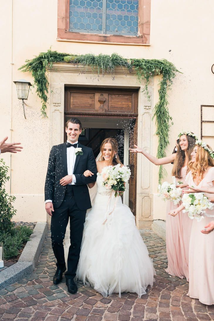 Welcome your guests to your wedding with a decked out entrance. Hang garlands or blooms over the doors to the church or reception venue.